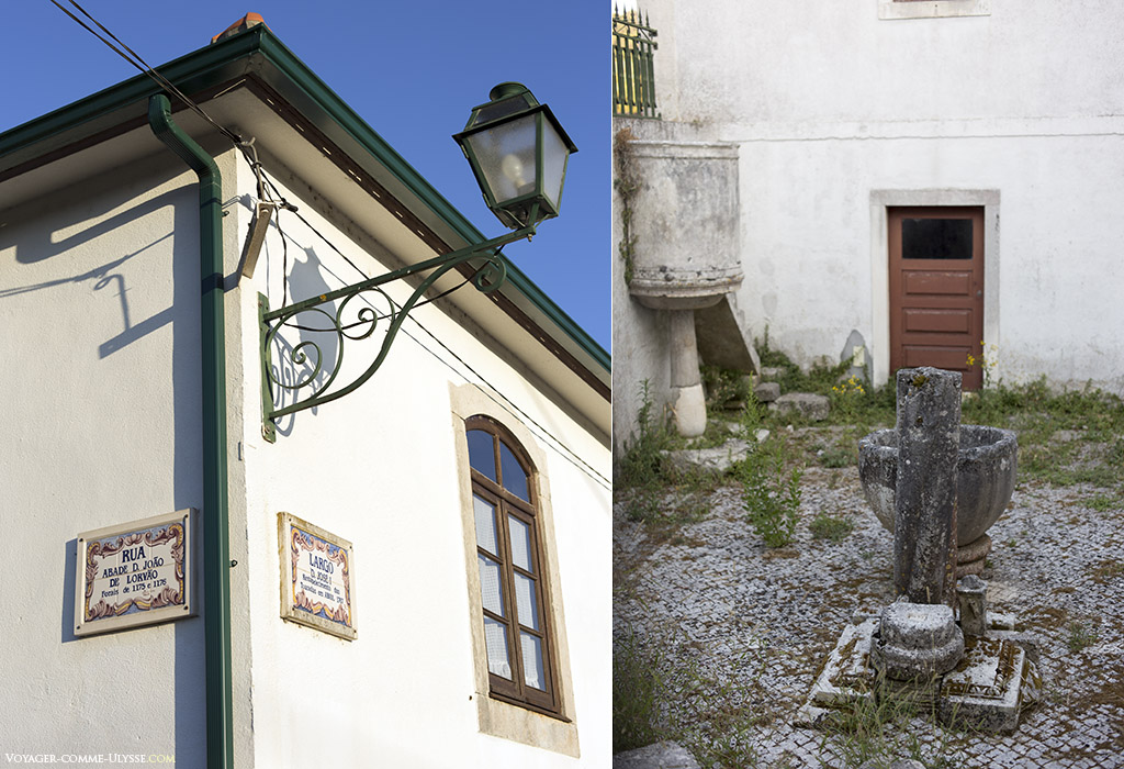 A gauche, un peu de mobilier urbain, avec les noms des rues sur des azulejos. A droite, une très vieille fontaine.